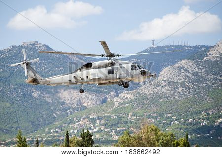 approach landing exhaust gas with aviation antennas on mountain background