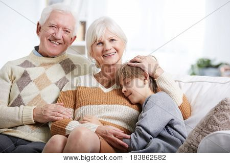 Boy Hugging To Grandmother