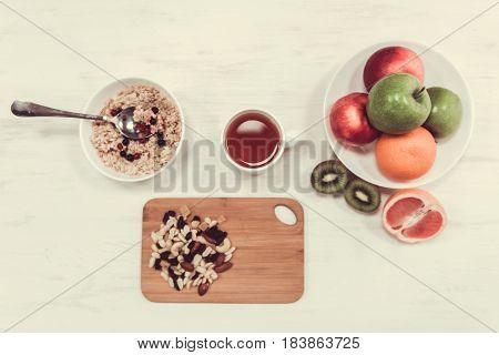 Healthy breakfast containing a fruits porridge and nuts full of nutrients