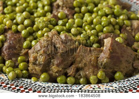 Traditional Moroccan dish with meat and peas close up