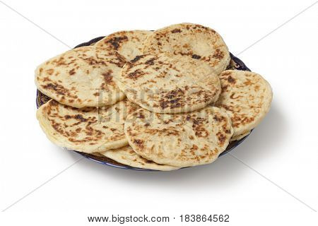 Traditional Moroccan pancakes, meloui for breakfast on white background