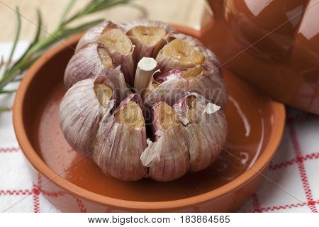 Roasted garlic in a ceramic bowl