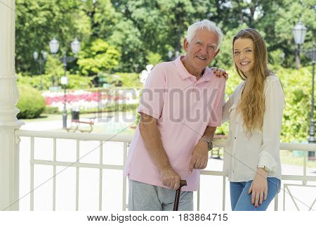 Senior Man With Caregiver In The Park