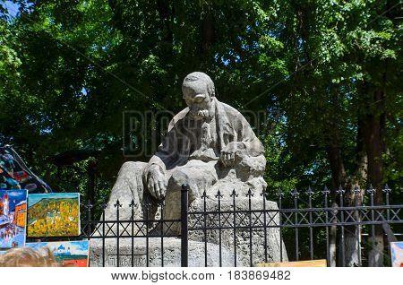 Kiev Ukraine - May 25 2013: Statue of Taras Shevchenko a famous Ukrainian poet at Andriyivskyy Uzviz Descent or Spusk in downtown