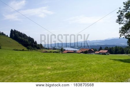 Deutschland: Allgau panorama. mountains and green meadows