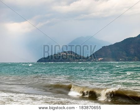 Pianello del Lario Italy: Storm on the lake creates a surreal atmosphere with waves and storm on the horizon
