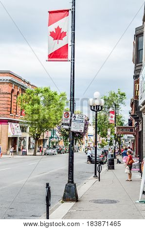 Kingston Canada - July 29 2014: Downtown street with flag banner and people
