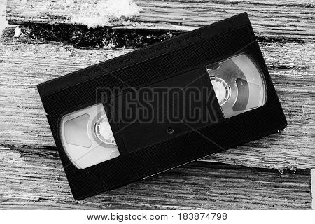 black ретро video cassette on the pieces of tree