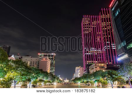 HO CHI MINH CITY VIETNAM - March 27 2917 : Ho Chi Minh City Hall on Nguyen Hue. Night view from Nguyen Hue. The Reverie Saigon building on right side.
