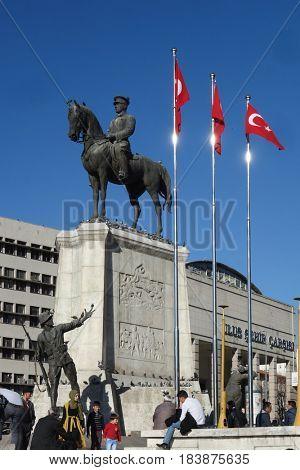 ANKARA, TURKEY - 02 APRIL 2017: The statue of Ataturk and national flags of modern Turkey in Ulus - Ankara, Turkey