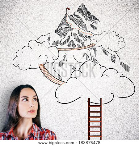 Thoughtful young woman on concrete background with drawn ladder clouds and way to mountain top. Success concept