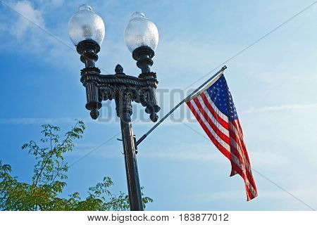 Lamp post with United States flag in Lawton Michigan