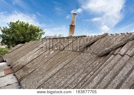Asbestos old dangerous roof tiles close up
