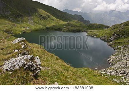 Tarn in Carpathians, Balea lake, Fagaras mountains Romania