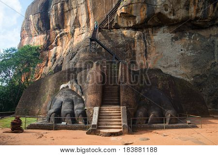 Two ancient lion's paws at the beginning of the ascent to the top of the mountain. Entrance to the upper part of the royal palace. Sigiriya. Sri Lanka