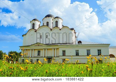 Veliky Novgorod, Russia.Summer view of St Nicholas Cathedral - one of the oldest cathedrals of Novgorod at Yaroslav Courtyard, Veliky Novgorod, Russia - architecture landscape of cathedral with dandelions on the foreground