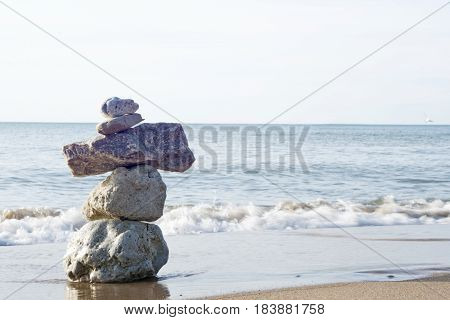 Cairn rock sculpture on the beach near St. Joseph Michigan.