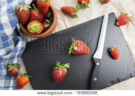 Red Ripe Strawberries  On A Table With A Knife And Kitchen Towel.