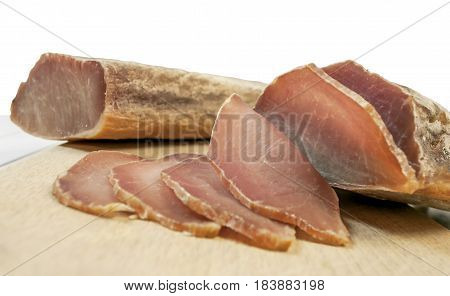 Two sirloin cut on a board on white table and white background