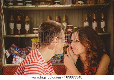 Close-up Of Young Beautiful Happy Loving Couple Sitting At Street Open-air Cafe Holding Hands Lookin