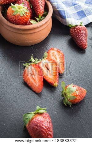 Red Ripe Strawberries  On A Table Some Sliced.