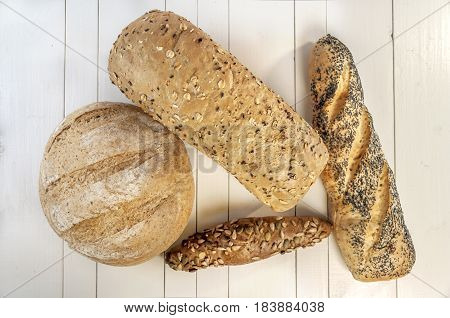 Various dietary baking bread isolated on white wooden table