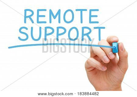 Hand writing Remote Support with blue marker on transparent wipe board.