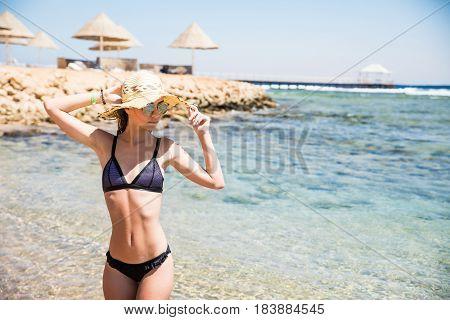 Beautiful Young Woman At The Beach Near Sea