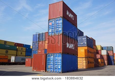 MILAN , ITALY 10 April 2017 : Several containers are ready to be loaded on to ships at the port. Containers are the classic method for maritime transport of different goods .