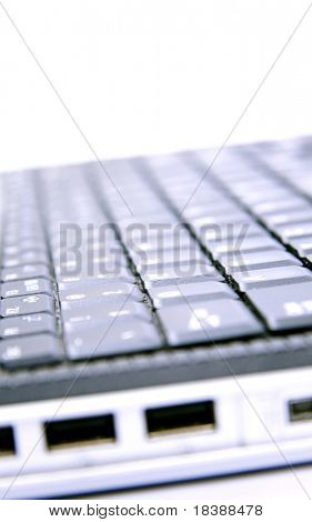 Notebook keyboard. Image with soft blue tint.
