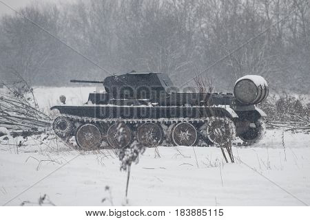LENINGRAD REGION, RUSSIA - JANUARY 15, 2017: German tank PzKpfw II Ausf D in the snowy forest before the attack on the position of the Soviet Army. Military-historical reconstruction of battles of the Second world war