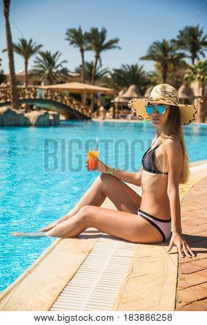 Young Woman In Swimsuit Relaxing With Cocktail Near Pool Summer Vocation