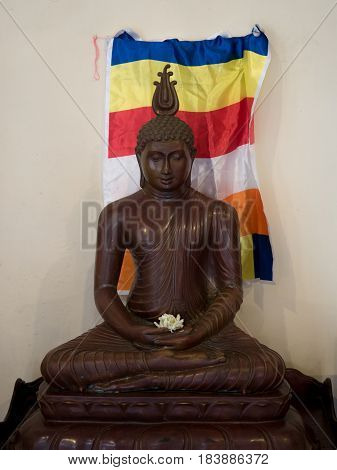 Buddha statue with a flag backround in the temple