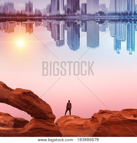 A man walking on a rock Looking for the future in the city.