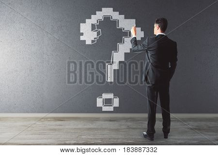 Back view of young businessman drawing question mark in interior. Inquiry concept. 3D Rendering