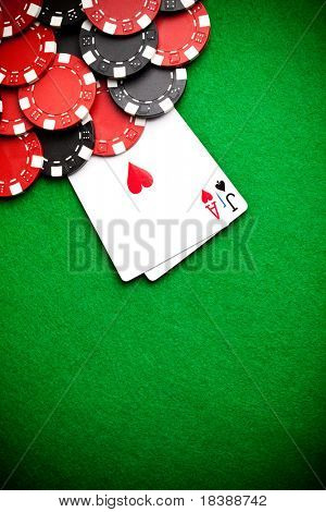 Black and red poker chips in the background