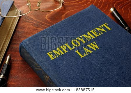 Book with title employment law on a table.