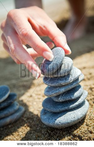 Woman stacking stones