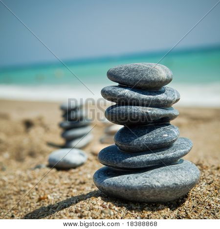 Stone stacks on a pebble beach