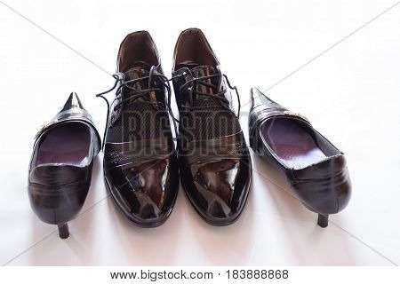 In the picture are patent man's shoes and the women's shoes.