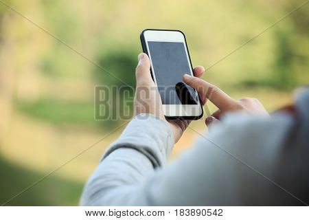 closeup of people hands use smart phone outdoor