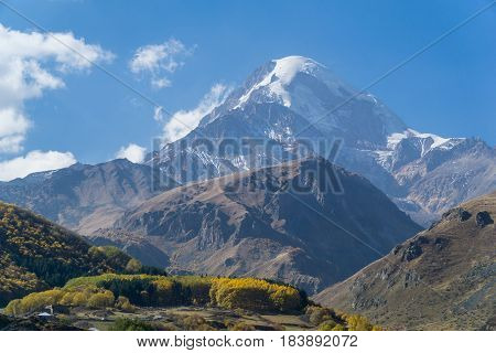 Mount Kazbek, view from Stepantsminda town in Georgia. It is one of the major mountains of the Caucasus. September