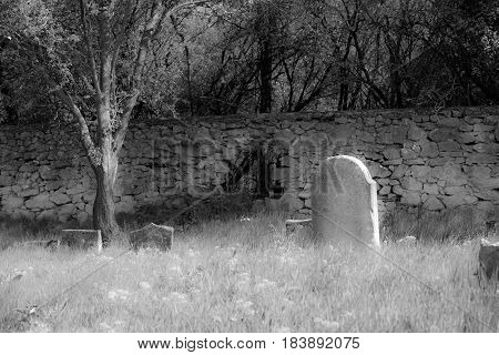 Old cemetery black and white, damaged gravestone
