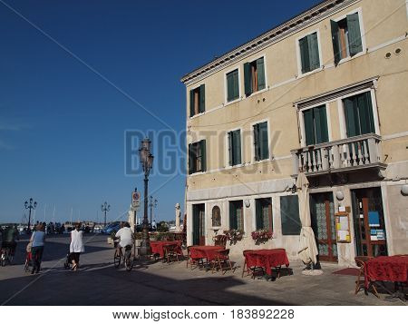 Chioggia, Italy.  Italian restaurant on the main street, just a few meters from the sea.