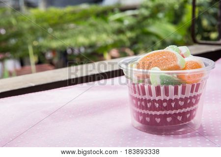 Candies. Jelly Candies In Cup On A Background. Jelly Candies In Bowl On A Background.