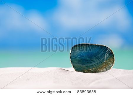 green glass stone on white sand beach,ocean,  sky and seascape