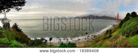 Panoramic view on Baker Beach, Pacific Ocean and Golden Gate Bridge from Presidio of San Francisco park.