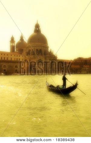 Gondola on Grand Canal in front of Santa Maria della Salute church in Venice.