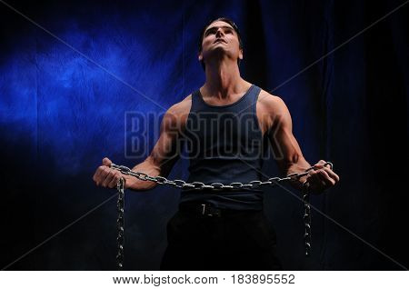 The tough guy is squeezing a chain tight.