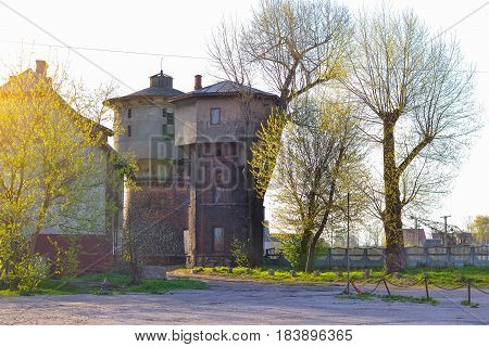 Water tower at station of Western railway Gumbinnen in East Prussia. Old German architecture in town Gusev Kaliningrad region Russia. Morning sunlight in spring